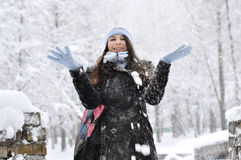 Girl throwing snow Royalty Free Stock Photos