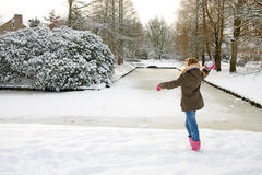 Girl is throwing snow ball Royalty Free Stock Images