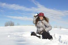 Girl throwing snow ball Royalty Free Stock Photo