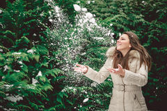 Girl throwing snow Stock Image