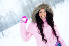 Girl throwing a snowball Stock Photos