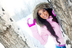 Girl throwing a snowball Stock Photography