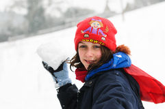 Girl throwing snowball Royalty Free Stock Photo