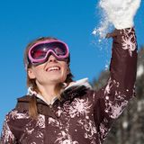 Girl throwing snowflake Royalty Free Stock Photo