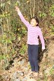 Girl throwing stone Royalty Free Stock Image