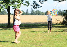 Girl throwing on a target Stock Photography