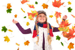 Girl throwing up autumn leaves Royalty Free Stock Photo