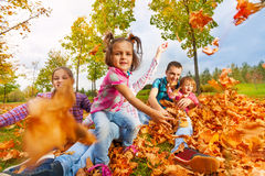 Girl throws autumn maple leaves to camera Stock Photography