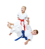 Girl throws boy on the white background isolated Royalty Free Stock Photos
