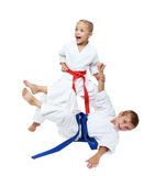 Girl throws boy on the white background isolated Royalty Free Stock Photo