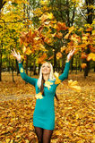 A girl throws leaves Royalty Free Stock Photos