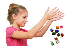 Girl throws miniature gifts Royalty Free Stock Photography