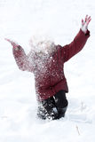 Girl throws snow Royalty Free Stock Photos