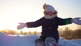 A girl throws snow above her head on sunset background stock video footage