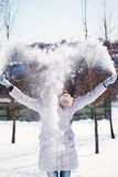 The girl throws snow in the frosty winter afternoon Royalty Free Stock Images