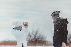 Girl throws snow at the guy`s face Stock Images