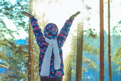 Girl throws snow in sunny winter forest. Girl throws snow in winter forest Stock Images