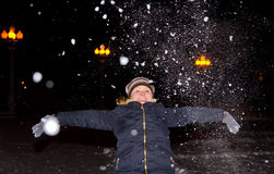 Girl throws up an armful of snow Royalty Free Stock Photos