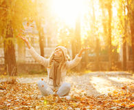 Girl throws up leaf litter. Autumn. Stock Images