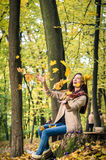 Girl throws up leaves Stock Photos