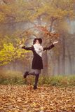 The girl throws up the leaves royalty free stock images