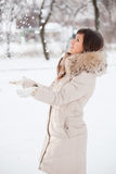 girl throws upwards snow Royalty Free Stock Images