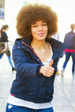 Girl with thumb up Stock Image
