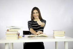 Girl thumb up while studying Royalty Free Stock Photo
