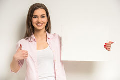 Girl with a thumb up Royalty Free Stock Images