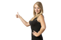 Girl with thumb up. Young blond girl in black top with thumb up Royalty Free Stock Image