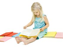The girl thumbs through the book Royalty Free Stock Photography