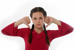 Girl thumbs down Royalty Free Stock Photos