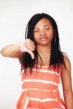 Girl thumbs down sign Stock Photography