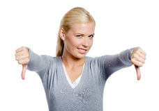 Girl thumbs down with two hands Royalty Free Stock Images