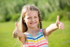 Girl thumbs up Stock Photos