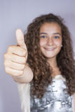 Girl with thumbs up, happy and successful Stock Photo