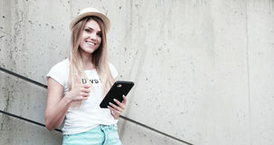 Girl with thumbs up using a tablet Royalty Free Stock Images