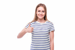 Girl with thumbs up on white background. Stock Images