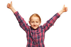 Girl thumbs up. Young Girl with thumbs up stock images