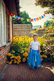 Girl in tiara at birthday party Stock Photography