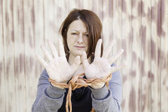 Girl tied hands Stock Image