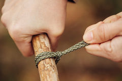 Girl ties a knot in the rope Royalty Free Stock Photo