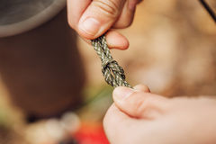 Girl ties a knot in the rope Stock Images