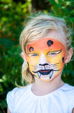 Girl with tiger face painting Royalty Free Stock Photos
