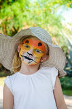 Girl with tiger face painting Stock Photo