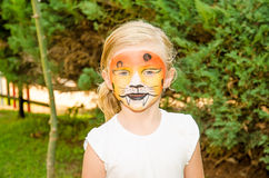 Girl with tiger face painting Royalty Free Stock Images