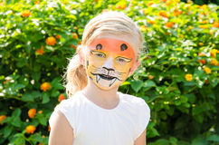 Girl with tiger face painting Royalty Free Stock Image