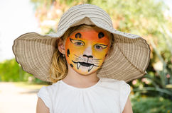 Girl with tiger face painting Stock Images