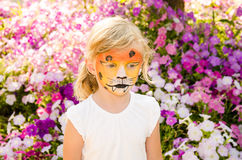 Girl with tiger face painting Stock Photography