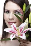 Girl with tiger lily Royalty Free Stock Photos